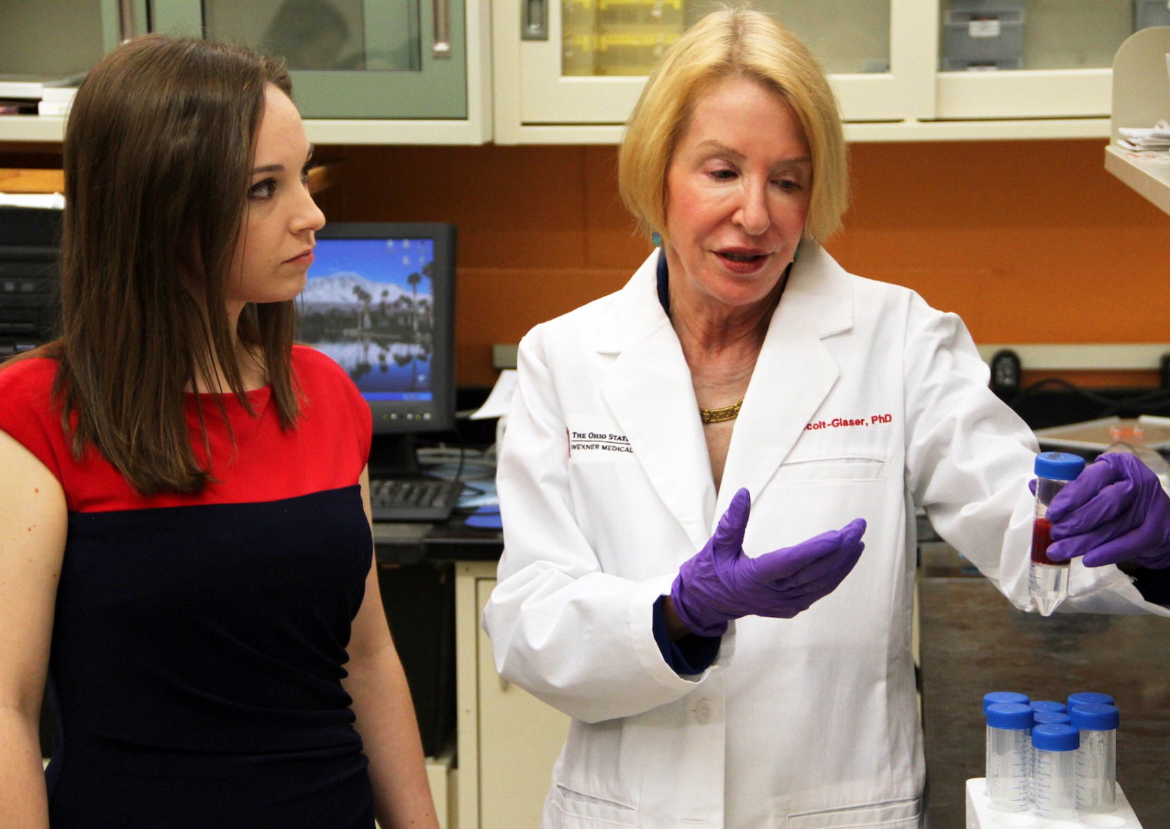 Ohio State scientists Stephanie Wilson (left) and Janice Kiecolt-Glaser examine a blood sample from a study conducted in the Clinical Research Center.