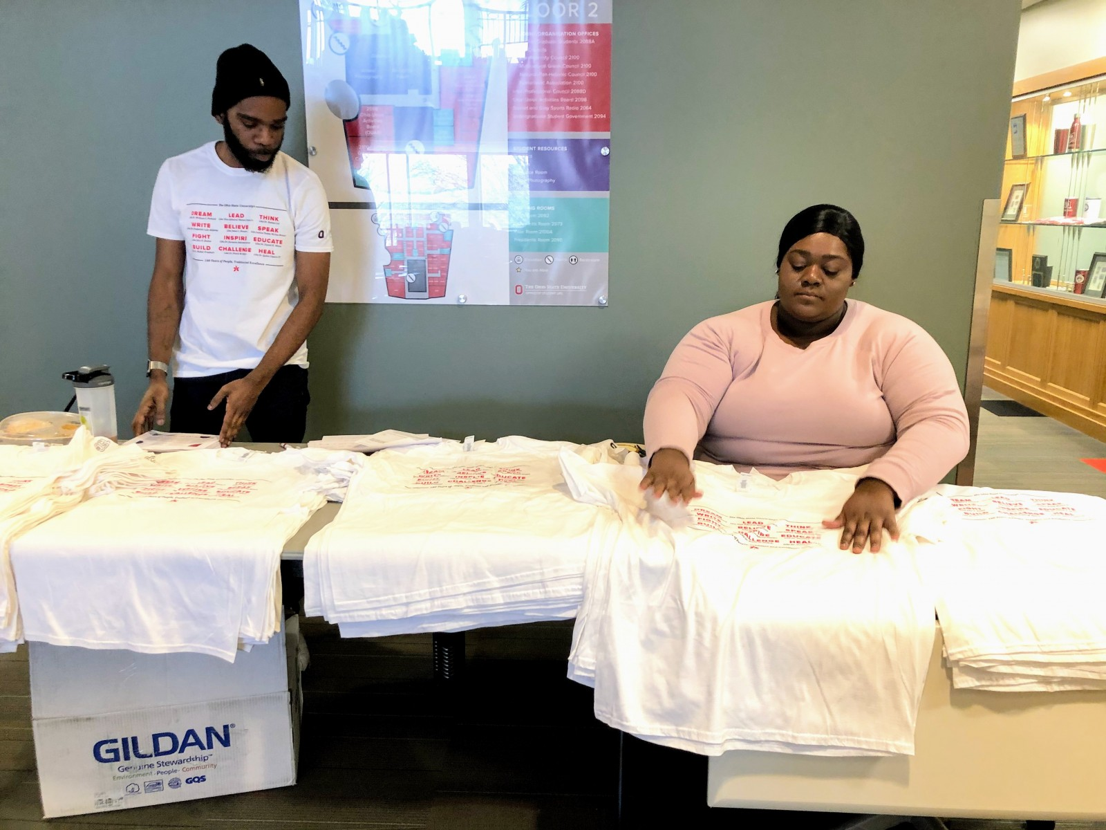 DaVonti' Haynes and Andrea Davis prepare T-shirts celebrating Ohio State's history of diversity