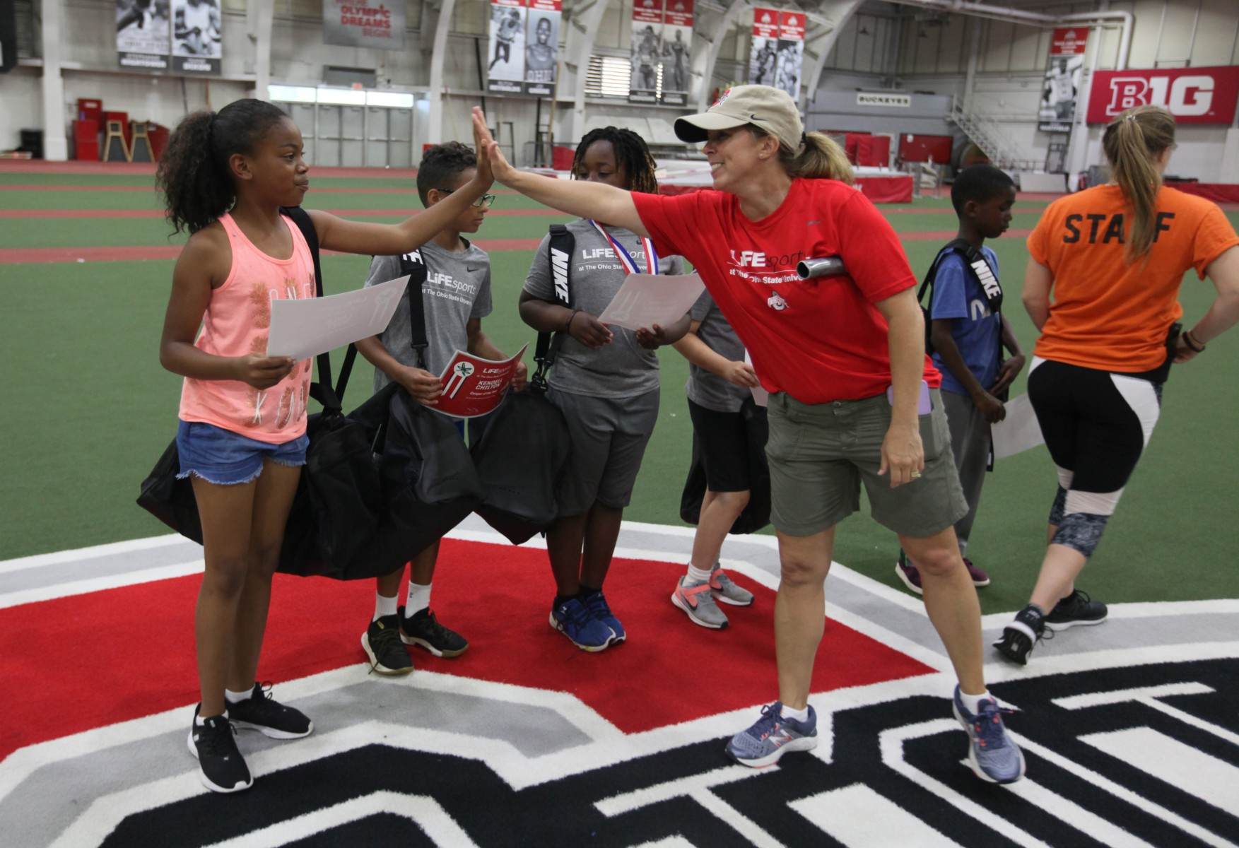 Dawn Anderson-Butcher, professor in the College of Social Work and executive director of teaching and research for LiFEsports, interacts with participants at the 2019 LiFEsports camp.