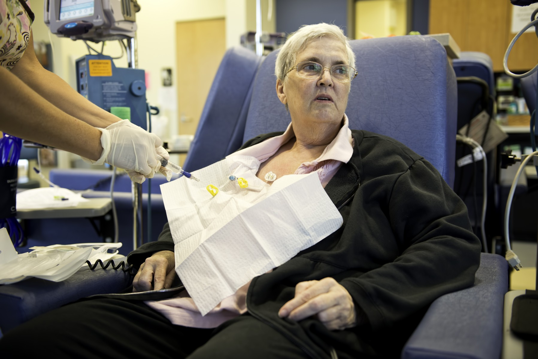 A cancer patient is prepped for a chemotherapy treatment.