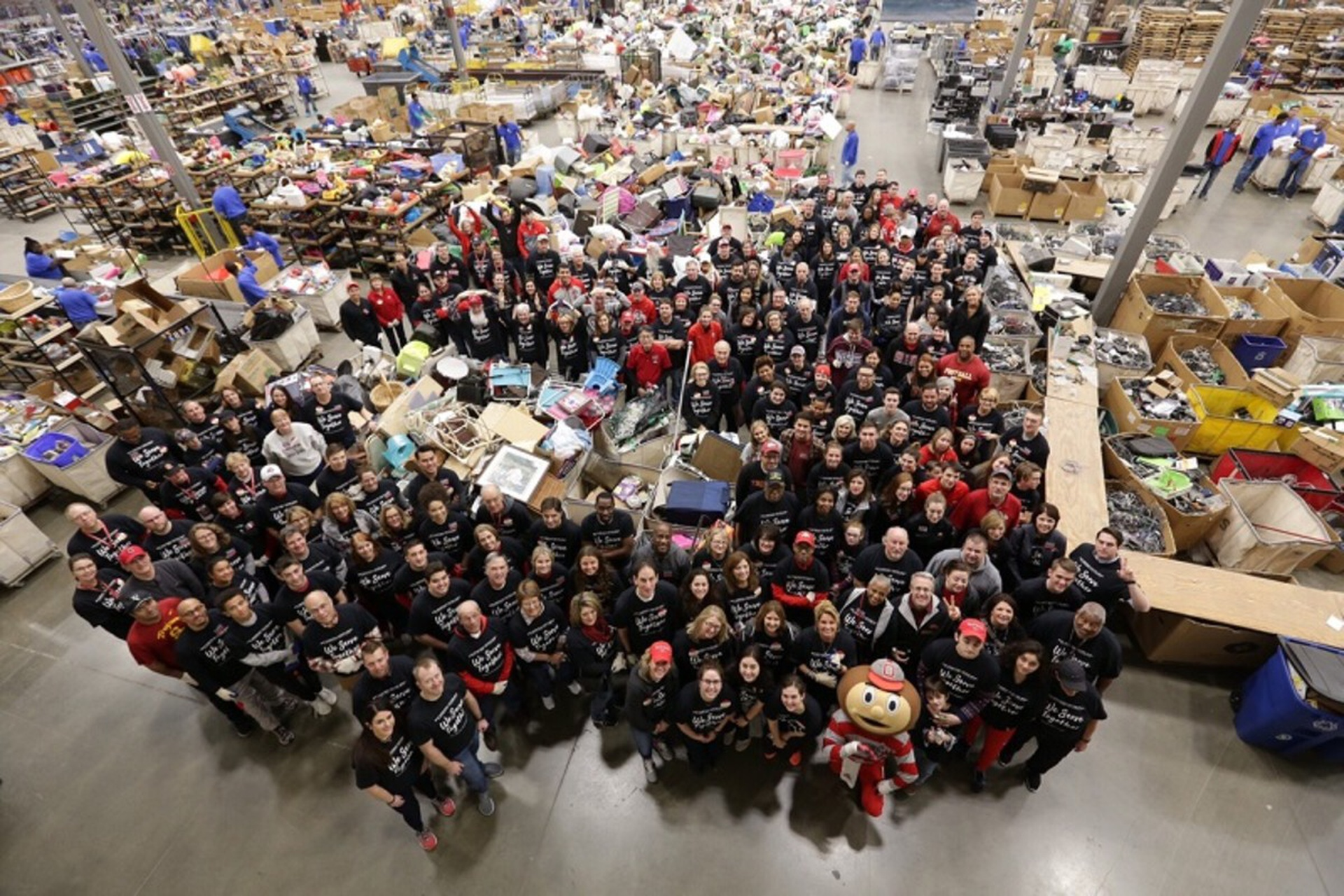 Dozens of volunteers help out at Goodwill in Dallas. Photo by Kevin Fitzsimons