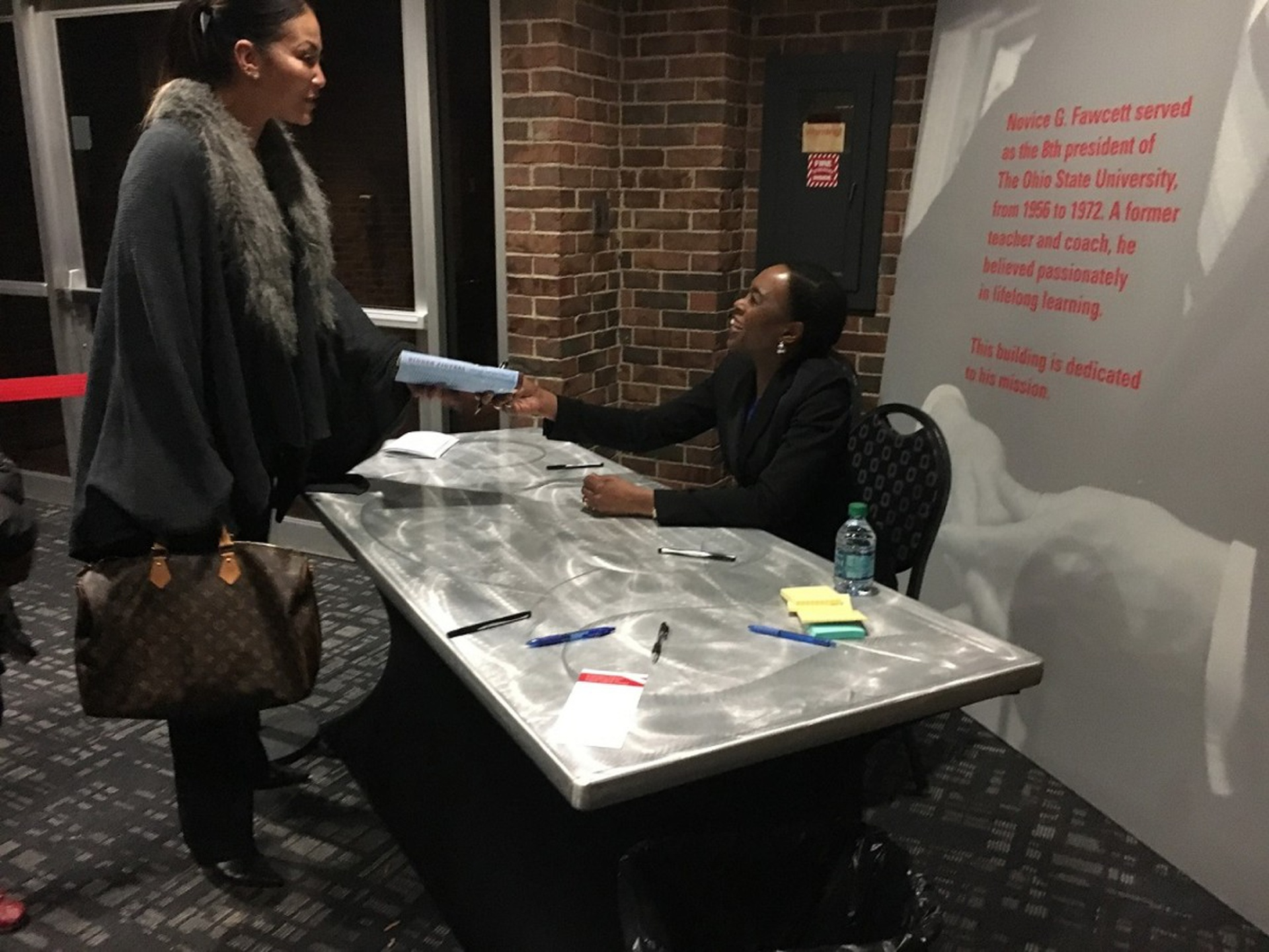 Margot Shetterly (seated) signs copies of her book Hidden Figures