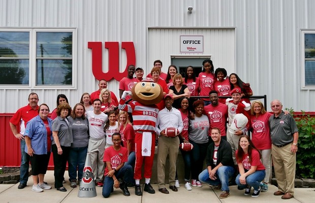 Brutus and President Drake on the State Tour at the Wilson Football Factory