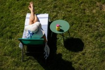 stock-photo-top-view-of-woman-sunbathing-in-back-yard-summer-fun-1773699203.jpg