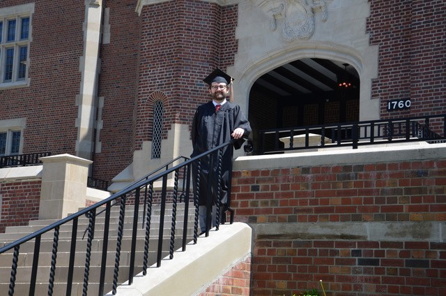 Damien Connelley takes photos on campus before graduation
