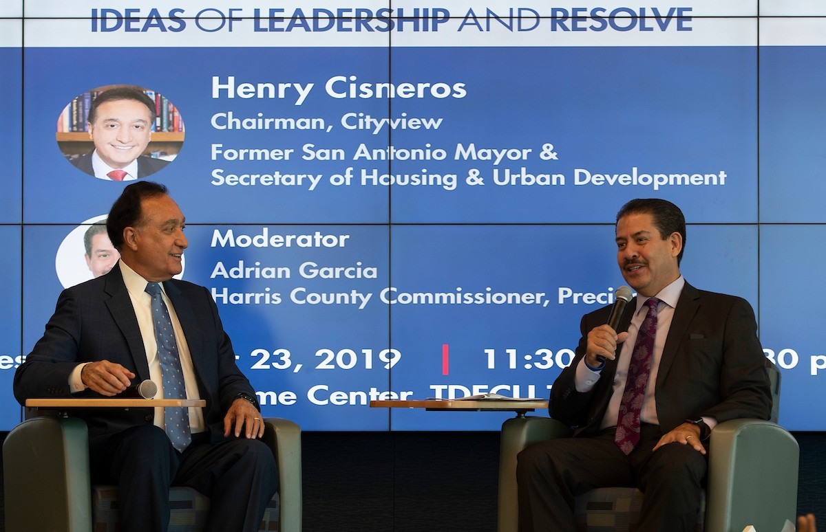 Henry Cisneros (left) and Adrian Garcia at the recent Gator Grit Speakers Series