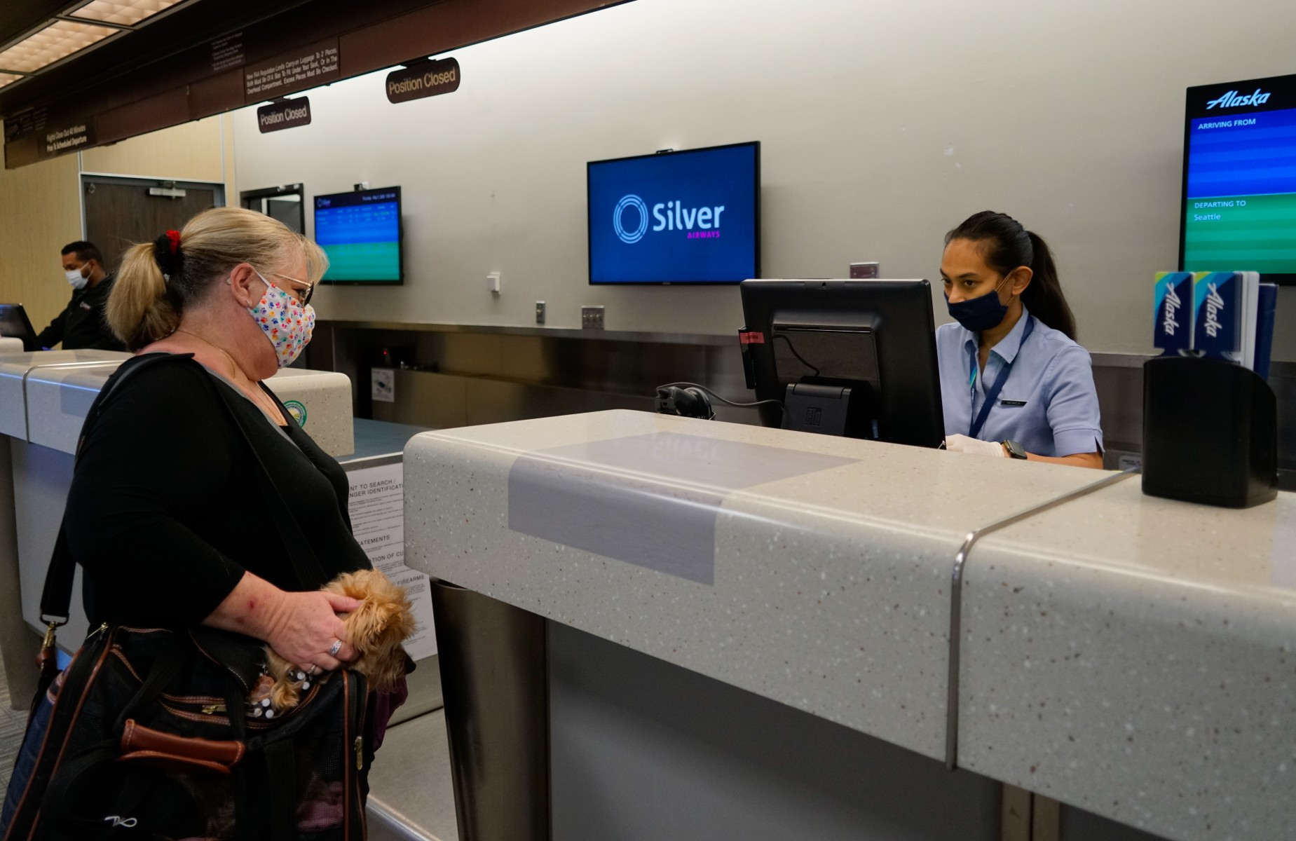 Check-in counter with masks