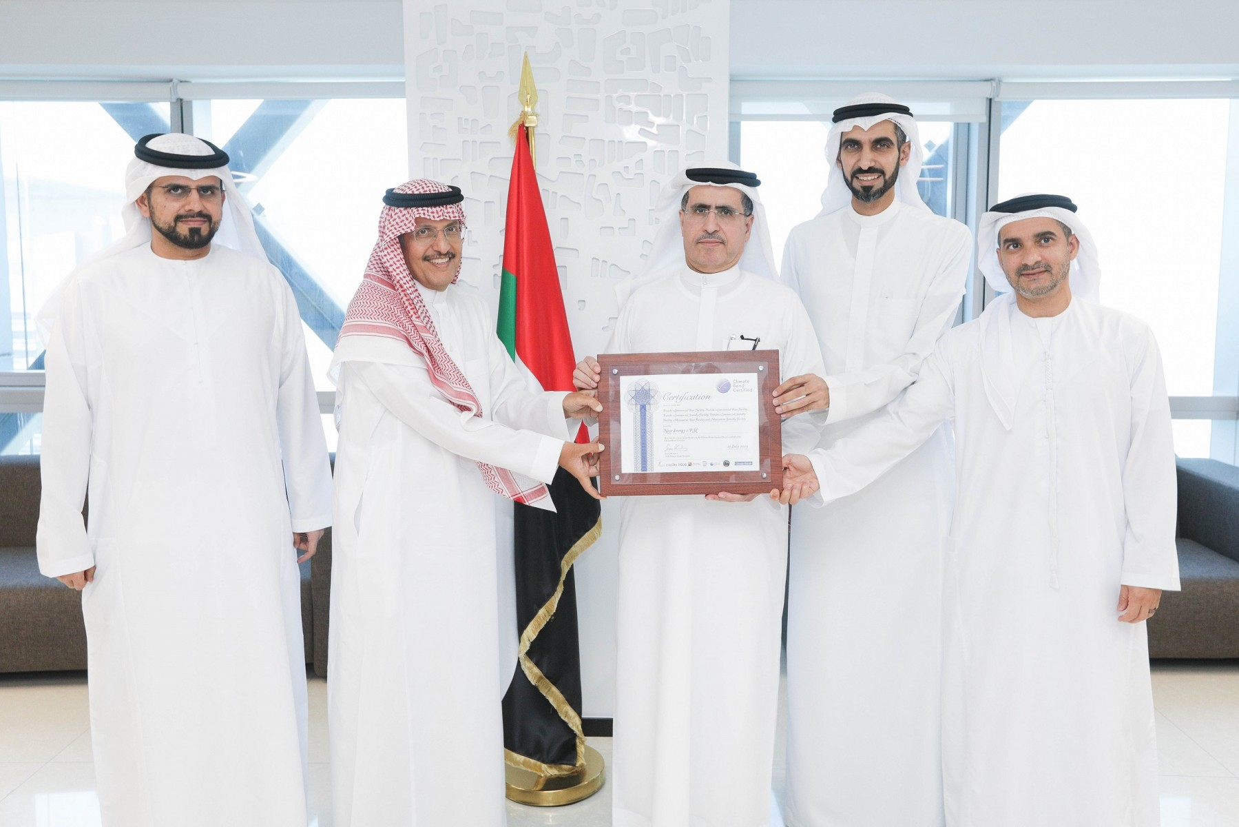 Officials from ACWA Power and DEWA