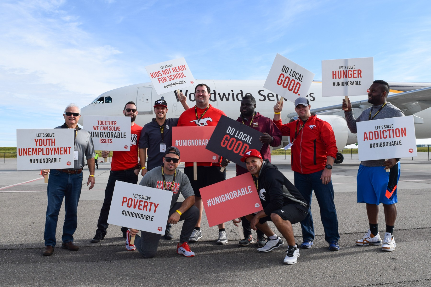 Calgary Stampeders alumni show their support for United Way of Calgary and Area at the annual Plane Pull event September 15.
