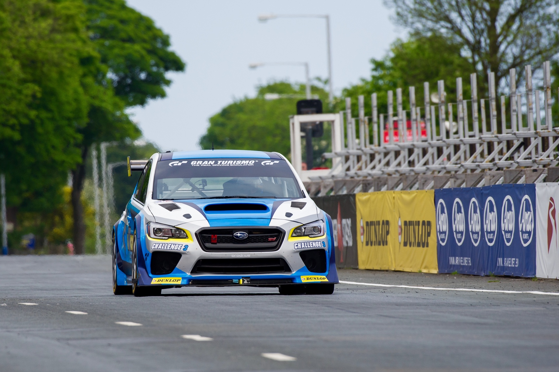 Flat Out. Mark Higgins points the Dunlop Subaru WRX towards the timing line