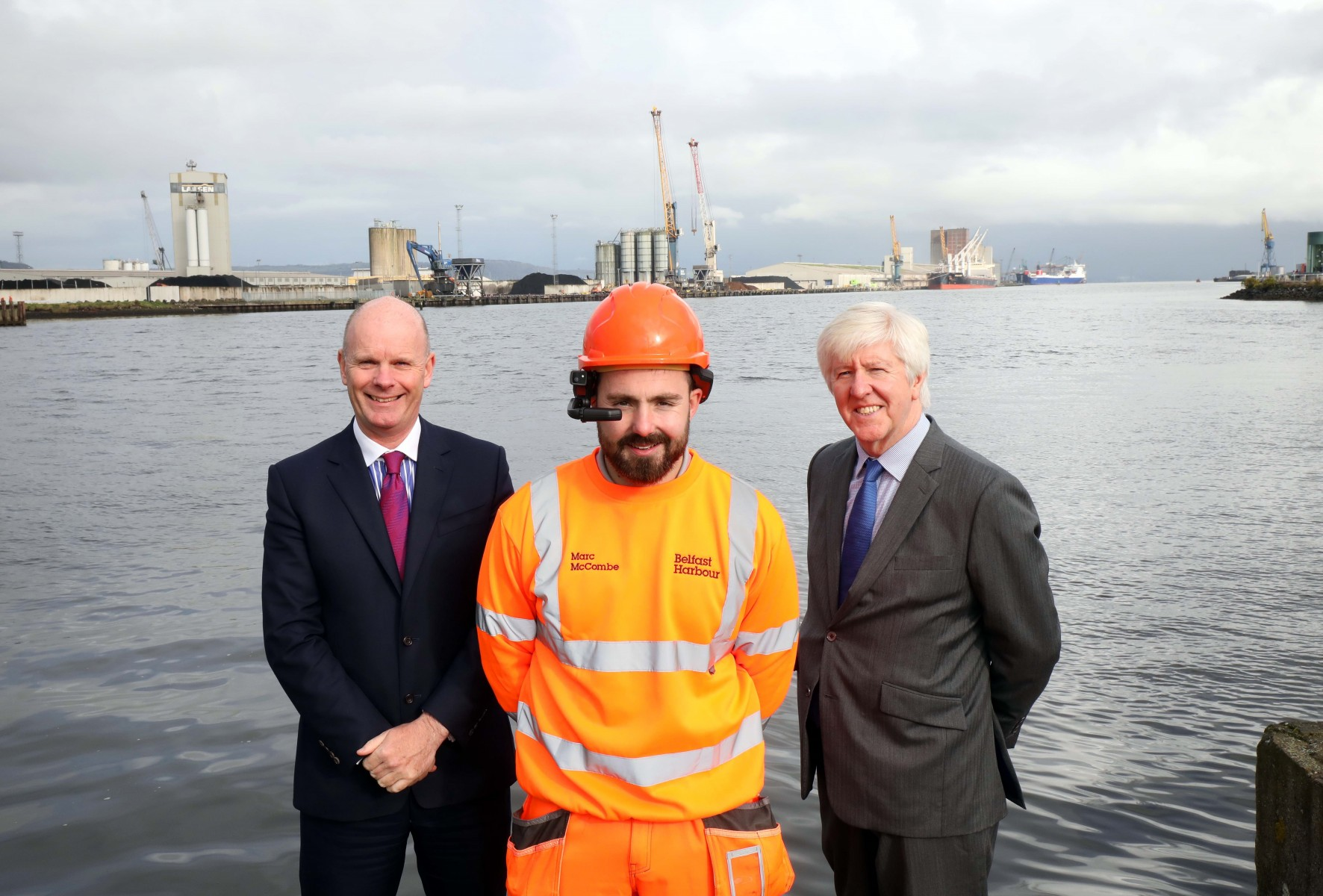 Joe O'Neill CEO Belfast Harbour, Gerry McQuade CEO BT Enterprise with Belfast Harbour Technician Marc McCombe  demonstrating the live 5G enabled device for remote c