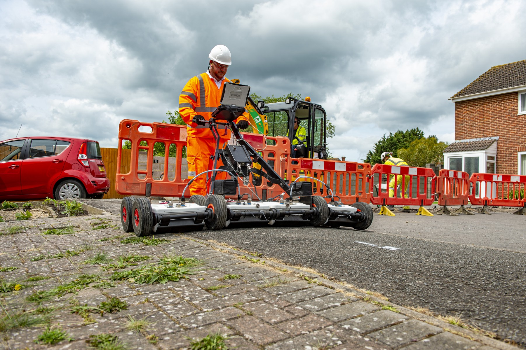 Engineer using Ground Penetrating Radar to help lay fibre cable