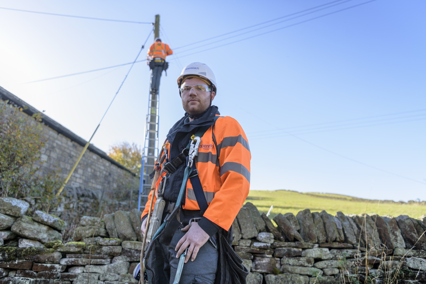 Engineer with pole climber in background