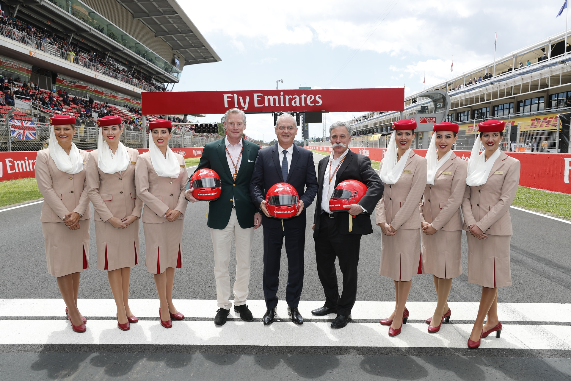From left to right: Sean Bratches, Managing Director, Commercial Operations at Formula 1, Thierry Antinori, Emirates Executive Vice President and Chief Commercial Officer, and Chase Carey, Chief Executive Officer of the Formula One Group, flanked by Emirates Cabin Crew, before the start of today's Spanish Grand Prix, of which Emirates is the Title Sponsor. Emirates and Formula 1® today announced a five year renewal of their Global Partnership.