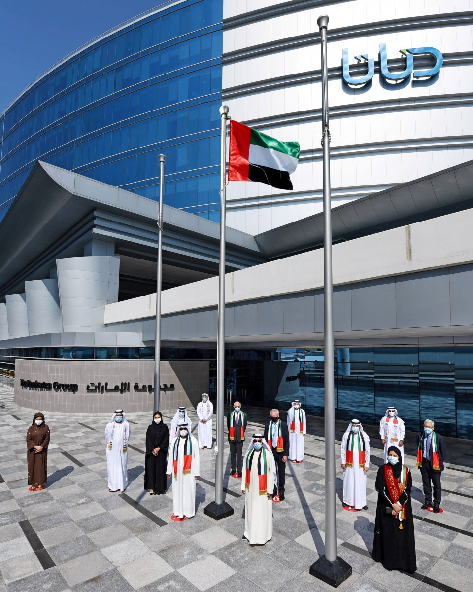 Emirates Group marks Flag Day with flag-raising ceremony
