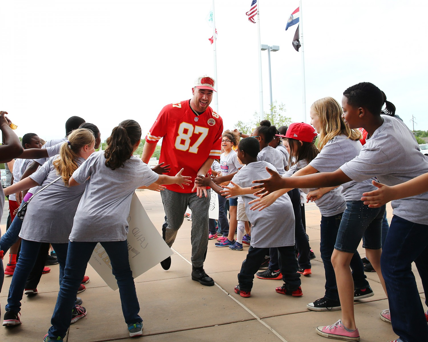 Helping kids is at the heart of Travis Kelce's commitment to community.  Please note that the image above was taken prior to the COVID-19 pandemic.
