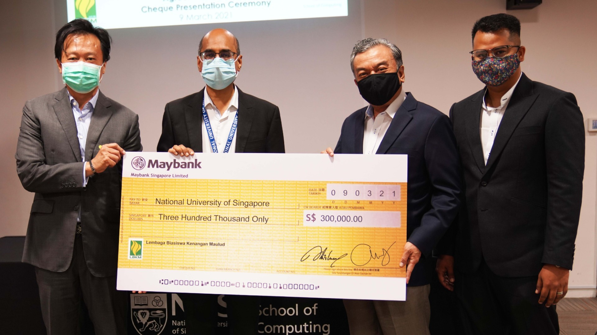 (From left) Mr Kevin Ong from the NUS Development Office; Prof Mohan Kankanhalli, Dean of the NUS School of Computing; Mr Suhaimi Salleh, President of LBKM, and Mr Abdullah Arief Ali, Honorary Treasurer of LBKM, at the cheque presentation ceremony.