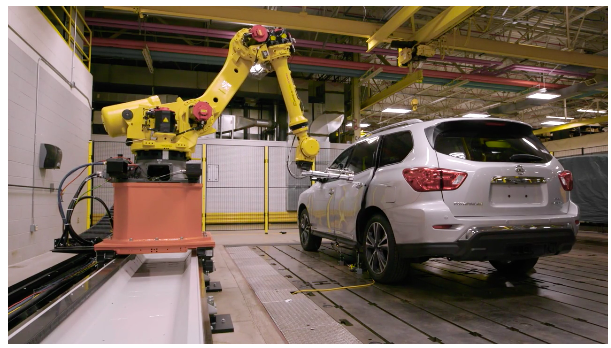 Robot testing a car in the factory