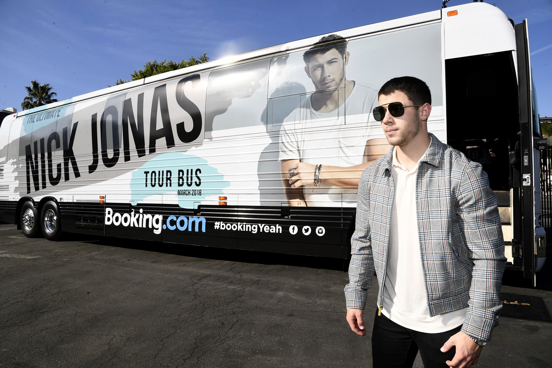 Nick Jonas celebrates the Booking.com 'Book the U.S. List' at his Ultimate Tour Bus on March 8, 2018 in Los Angeles, California.