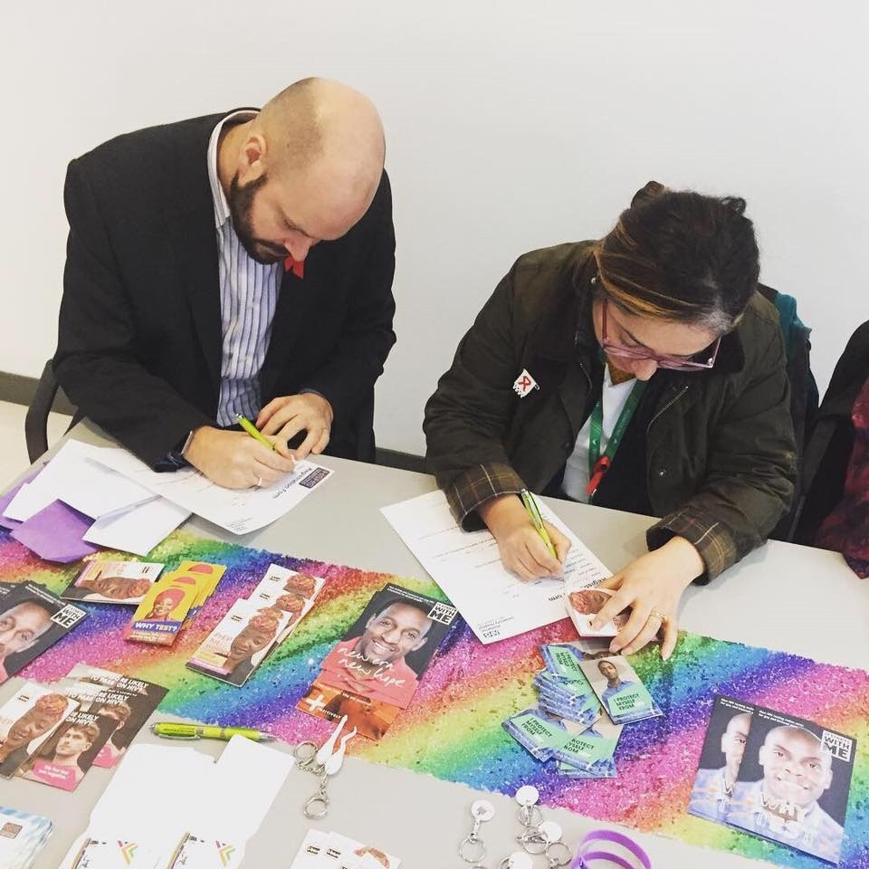 Cllr Feryal Demirci and the Mayor Philip Glanville at the HIV testing stall in Hackney Service Centre provided by Homerton Sexual Health Services