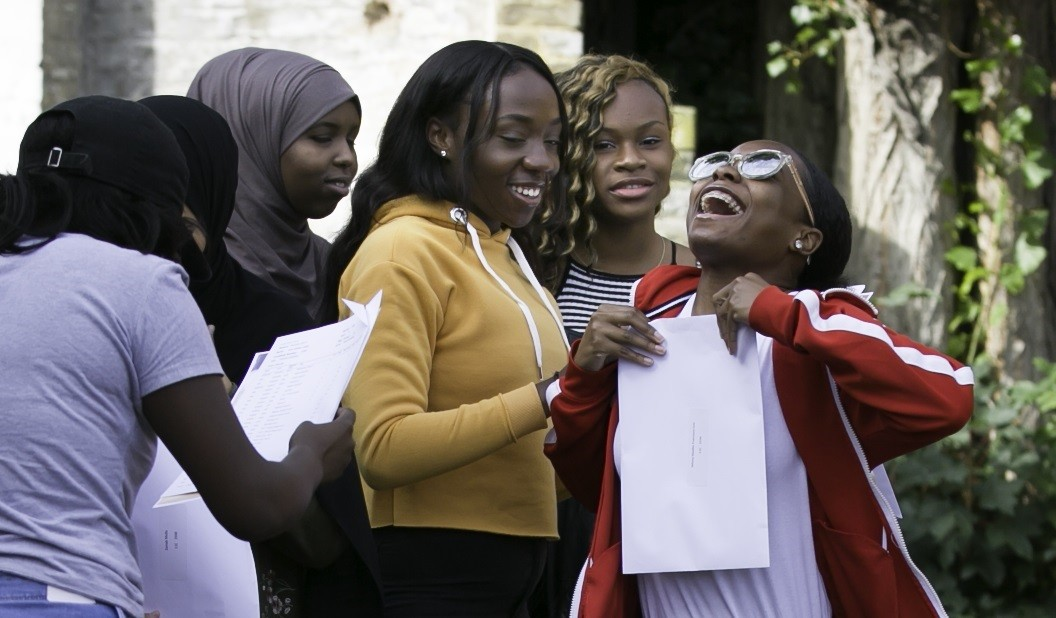 Students at Clapton Girls Academy celebrate their 2017 GCSE results