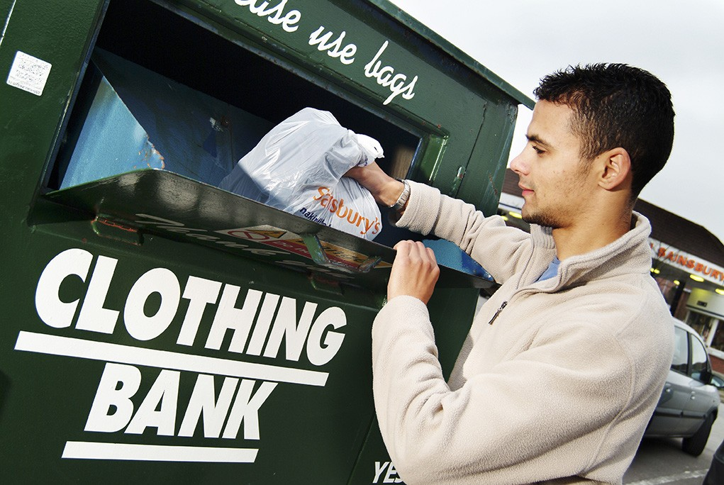 web0212_-_Man_putting_carrier_bag_of_clothes_into_a_clothing_bank_-_Web_Version__72ppi