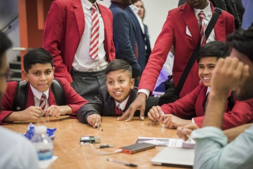 Inspired young men learn about the tech industry