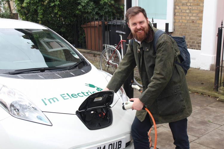 Cllr Jon Burke, Hackney Council Cabinet Member for Energy, Waste, Transport and Public Realm with one of the Council's electric vehicles