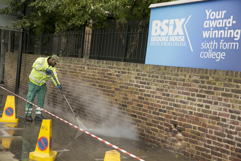 The pavement is steam cleaned for Clean up Clapton Day